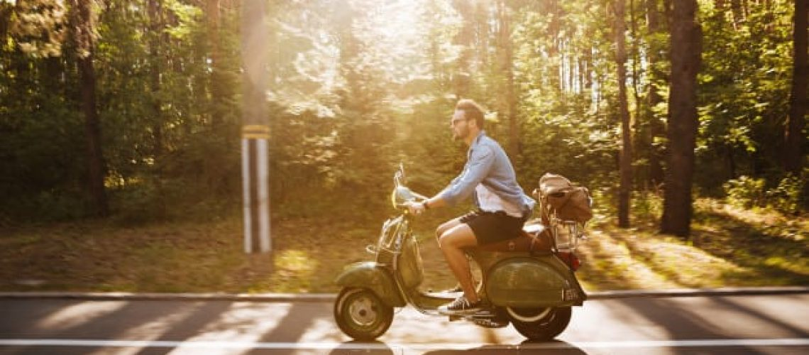bearded-man-scooter-outdoors-looking-aside_171337-6231